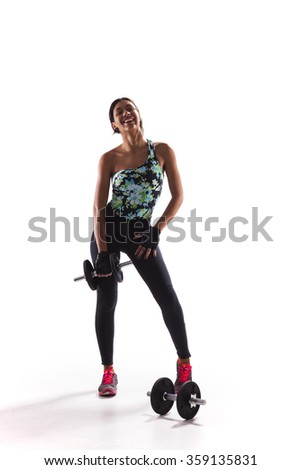 Woman exercising with dumbbells isolated on white - stock photo