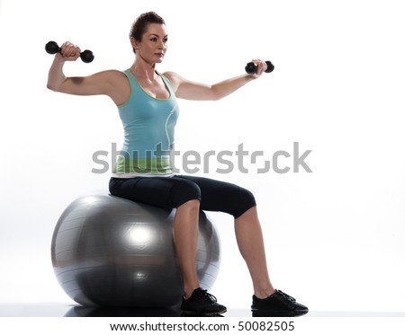 woman exercising workout on white background. Seated Swiss Ball Lateral Arm Raise