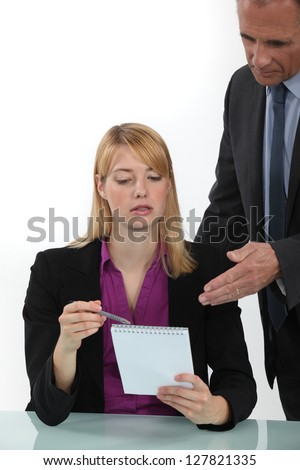 Woman explaining point to boss - stock photo