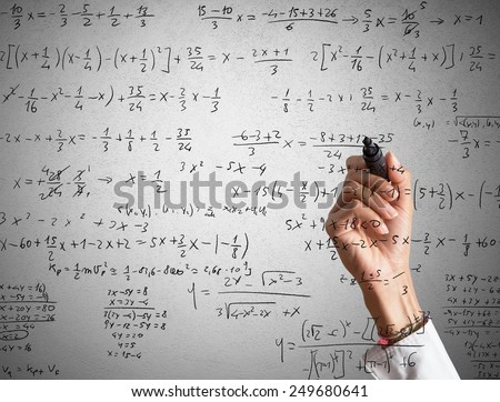 Woman explains and solves a mathematical calculation - stock photo