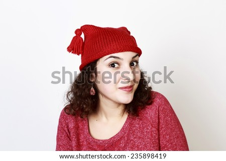 Woman expressing happiness in Christmas mood, isolated - stock photo