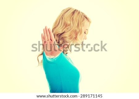 Woman expressing NO gesture with hand - stock photo