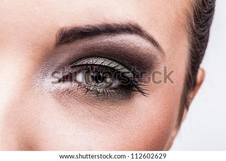 Woman eye with beautiful makeup - stock photo