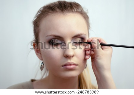 Woman eye with beautiful makeup and long eyelashes - stock photo