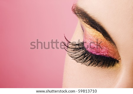 Woman eye with beautiful makeup. Space for text. - stock photo