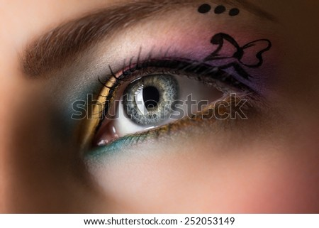 Woman eye with colorful make-up. - stock photo