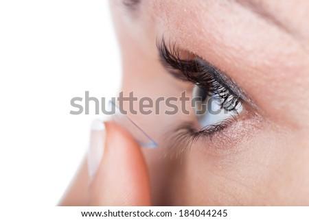 Woman eye with contact lens applying, macro - stock photo