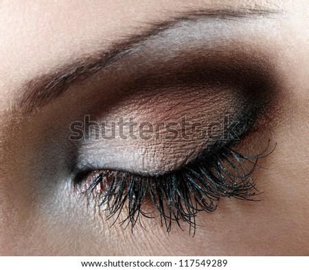 Woman eye with extremely long eyelashes - stock photo