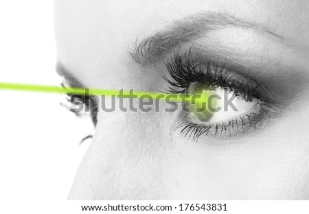Woman eye with laser correction in shades of grey - stock photo