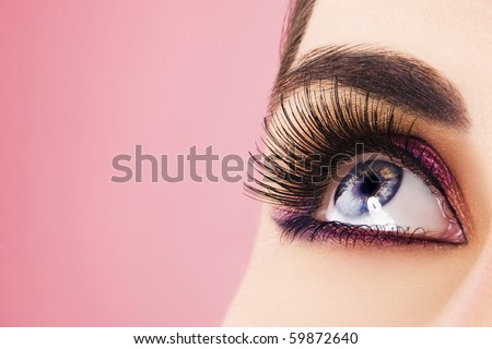 Woman eye with long eyelashes. Space for text. - stock photo