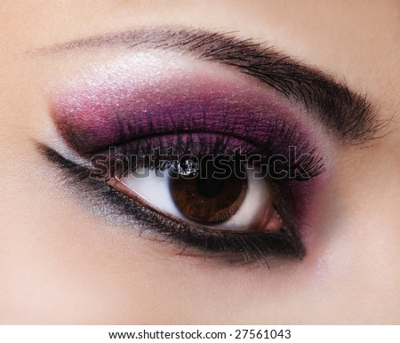 Woman eye with style violet and fashion make-up - stock photo