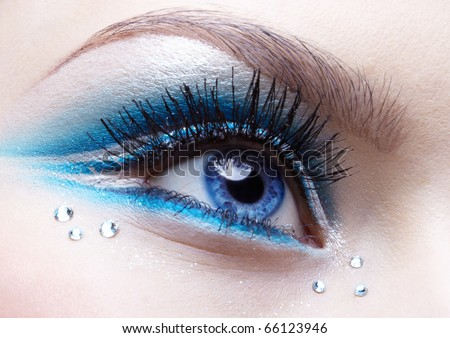 woman eye zone make-up in blue and white tone - stock photo