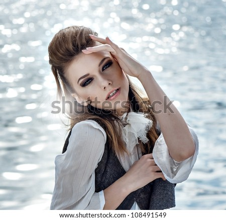 woman face against water reflections - stock photo