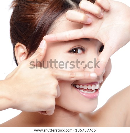 Woman face and eye care and she making frame with hands, asian woman - stock photo