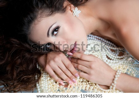 woman face and pearls - stock photo