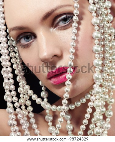 woman face and pearls