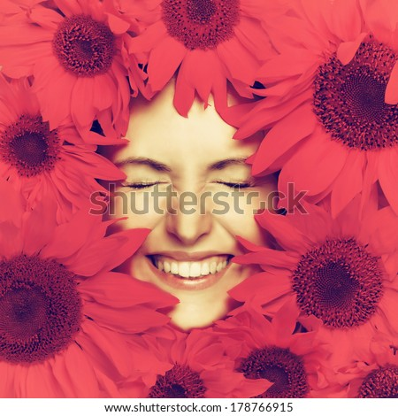Woman face and pink flowers. Filtered image - stock photo