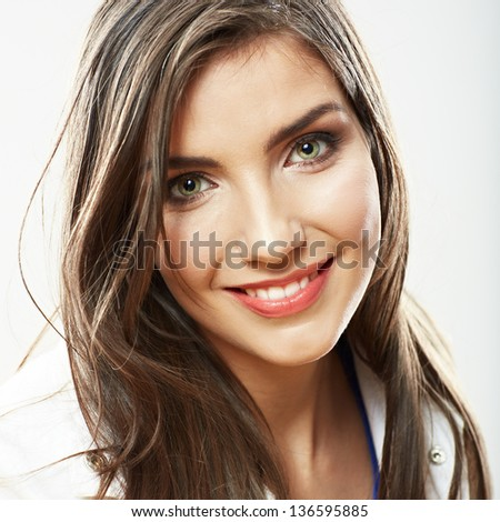 Woman face close up white background isolated. Smiling girl portrait. Female model studio poses.