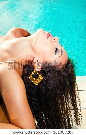 woman face leaning back exposed to the sun - stock photo