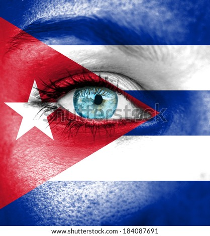 Woman face painted with flag of Cuba