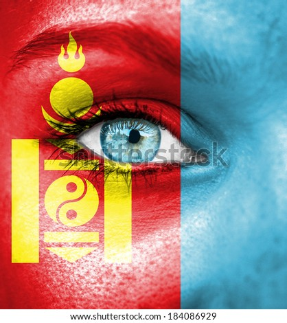 Woman face painted with flag of Mongolia