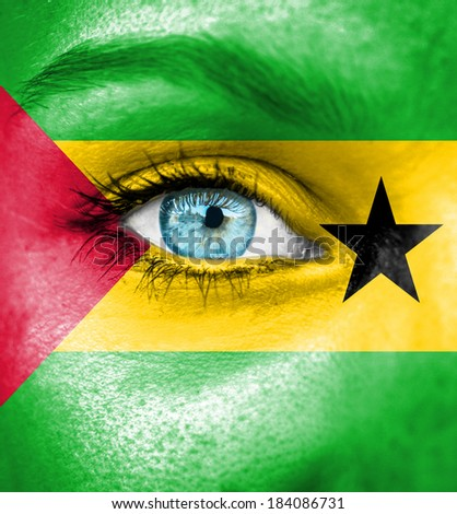 Woman face painted with flag of Sao Tome and Principe