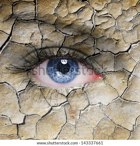 Woman face with cracked brown earth pattern - stock photo