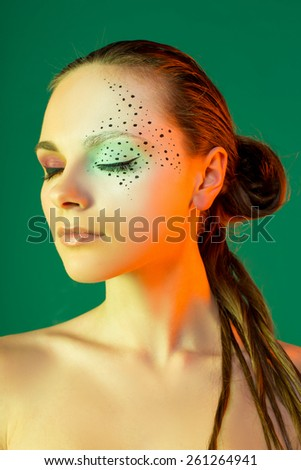 Woman face with fashion make up - stock photo