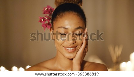 Woman Face With Fresh Flower - stock photo