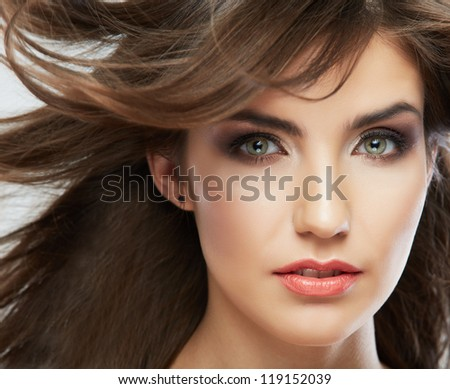 Woman face with hair motion on white background isolated close up portrait. Female model with long hair.