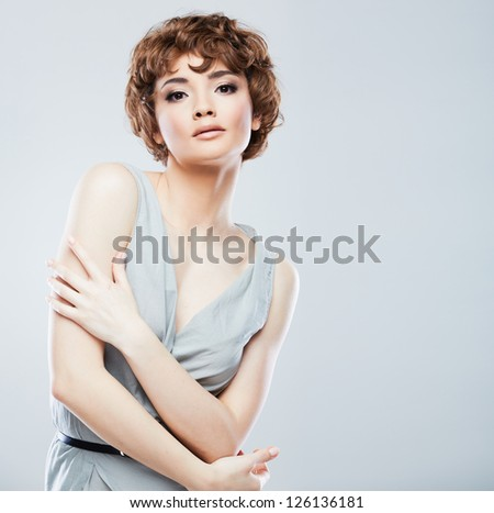 Woman face with hair style on white background isolated close up portrait. - stock photo
