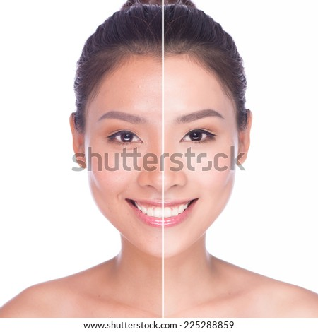Woman face with half tan skin. Beautiful asian woman portrait portrait of tanned beauty young female with beautiful makeup looking at camera and smiling isolated on white background  - stock photo