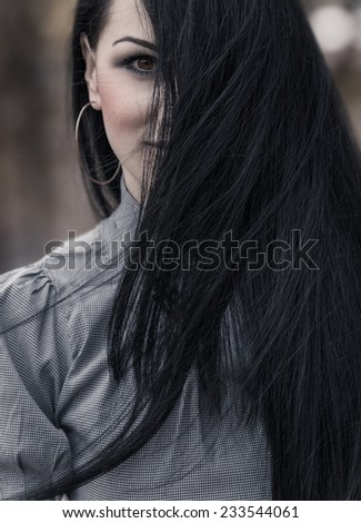 Woman face with long black hair. Hairstyle or hairdoo on wind. Close up female - stock photo