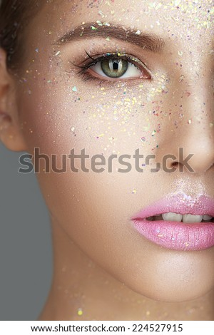 Woman face with pink lips close-up