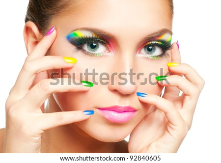 Woman face with rainbow makeup and manicure - stock photo