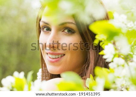 Woman face with white blossom flowers  - stock photo