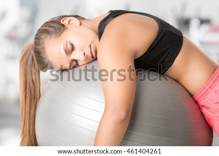 Woman falling asleep in the gym, in a gym