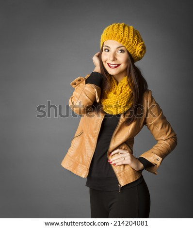 Woman Fashion Beauty Portrait, Model Girl In Autumn Season Clothing Posing in Studio, Yellow Fall Style over gray background - stock photo