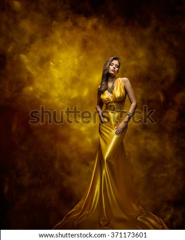 Woman Fashion Model Gold Dress, Beauty Girl in Glamour Gown - stock photo