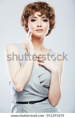 Woman fashion model studio portrait. Studio posing dress wearing. Isolated background.