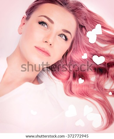 Woman fashion portrait, hair idea for Valentine's day, stylish pastel pink hair color, trendy wavy long hairstyle, beautiful model with romantic look - stock photo