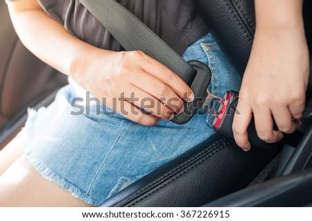 Woman fastening car seat belt before drive. - stock photo