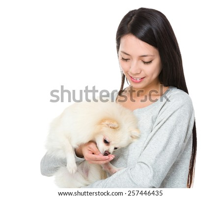 Woman feed her dog - stock photo