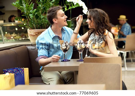 Woman feeding her husband - stock photo