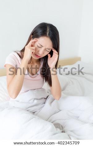 Woman feeling headache - stock photo
