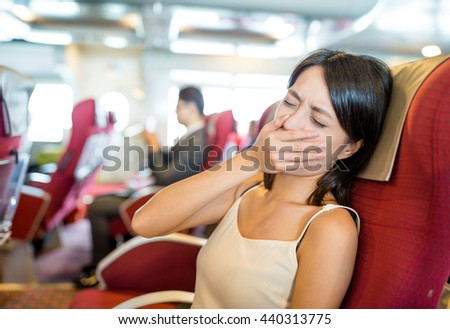 Woman feeling sick on boat
