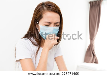 Woman feeling unwell at home - stock photo
