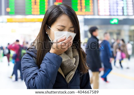 Woman feeling unwell at train station - stock photo