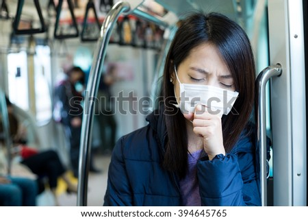 Woman feeling unwell in train compartment - stock photo