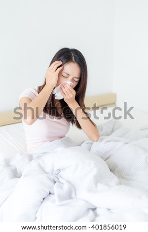 Woman feeling unwell when waking up